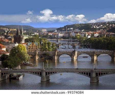 Prague - skyline with Vltava River and Charles Bridge - stock photo
