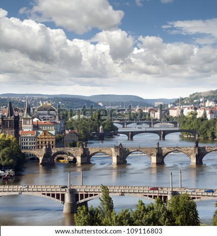 Prague - skyline with Vltava River bridges, Old Town towers, Smichov Quarter and Charles Bridge, Czech Republic