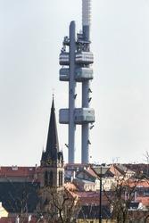Prague skyline with Zizkov television tower transmitter and Church of Saint Procopius, sunny day, Czech Republic