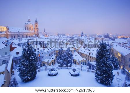 prague - st. nicolas church and rooftops of mala strana in winter - stock photo