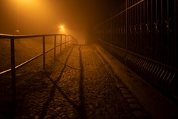 Prague streets in fog with lights