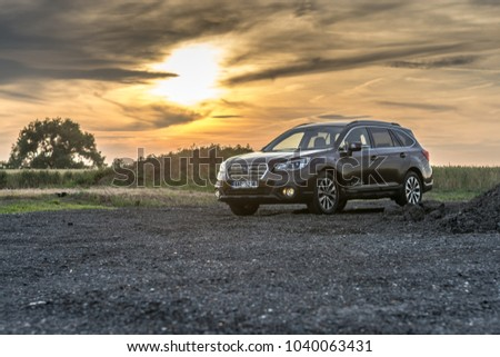 PRAGUE, THE CZECH REPUBLIC, 8. 7. 2017: New Subaru Outback, model year 2017 in Czech in sunset #1040063431