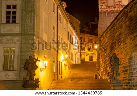 Prague - The stairs Radnické schody with the statues of St. Joseph and St. John the Nepomuk under the Castle at night. Zdjęcia stock ©