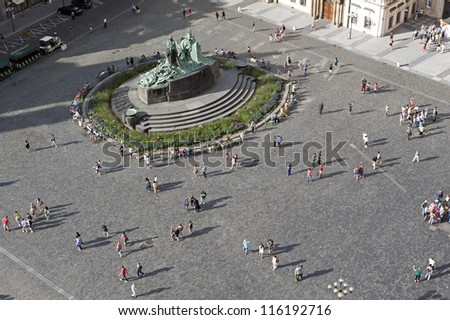 Prague - tourists at the Old Town Square, close to Monument of Jan Hus