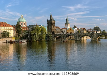 Prague, View of Charles Bridge with Old Town bridge tower and Dome of the church of Saint Francis of Assisiat the end of a summer day, Czech Republic