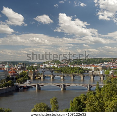 Prague - Vltava River and Charles Bridge with clouds