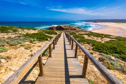 Praia da Bordeira and boardwalks forming part of the trail of tides or Pontal da Carrapateira walk in Portugal. Amazing view of the Praia da Bordeira in portuguese. Bordeira, Algarve, Portugal.