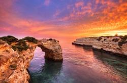 Praia de Albandeira - beautiful coast of Algarve at sunset, Portugal.