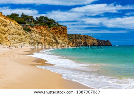 Praia de Porto de Mos in Lagos, Portugal. Praia do Porto de Mos, long beach in Lagos, Algarve region, Portugal. Beautiful golden beach, surrounded by impressive rock formations.  Stock fotó ©