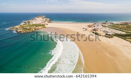 Praia do Campismo and Island Baleal naer Peniche on the shore of the ocean in west coast of Portugal