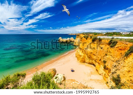 Praia dos Tres Castelos in south Portugal, Portimao, Algarve region. Landscape with Atlantic Ocean, shore and rocks in Tres Castelos beach (Praia dos Tres Castelos), Algarve, Portimao, Portugal. Zdjęcia stock ©