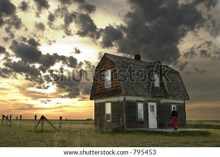 Prairie Landscape with an old house and person