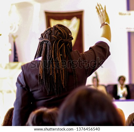 Praise and worship concept of a Christian raising hand while praising Jesus