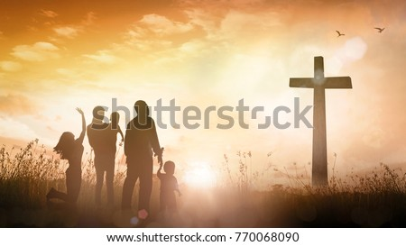 Praise and worship concept: Silhouette christian family looking for the cross on autumn sunrise background
