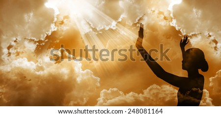 Praise the lord-Woman worshipping god at sunset #248081164