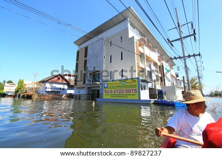 PRATHUMTHANI, THAILAND - NOV 28 : flooded street after flood disaster in Nava nakorn, Prathumthani, Thailand on November 28, 2011.
