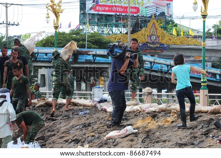 PRATHUMTHANI, THAILAND - OCTOBER 15: Thai army builds a mud barrier on Klong one river to prevent flooding from Ayutthaya and north Thailand on October 15, 2011 in Prathumthani, Thailand.