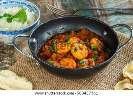 Shutterstock Prawn curry with rice and popodoms