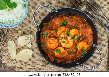Shutterstock Prawn curry with rice and popodoms - top view