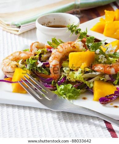 prawn salad with fresh mango fruit on tray