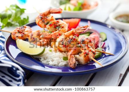 Prawn skewers with rice and vegetable salad