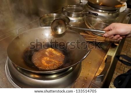 Prawns being fried in wok pan