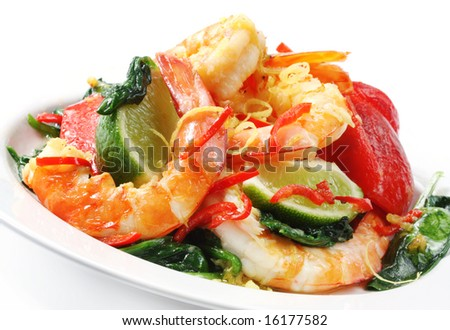 Prawns grilled with spinach, bell pepper, chili, lemon zest, and lime.  Delicious healthy eating.