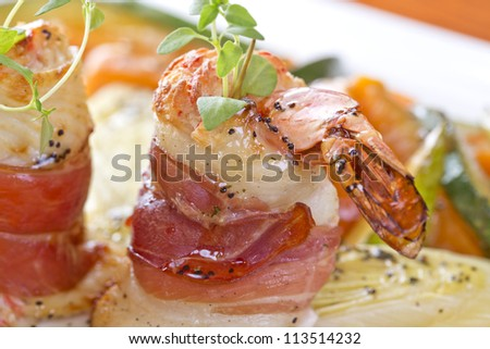 prawns wrapped in fish and parma ham