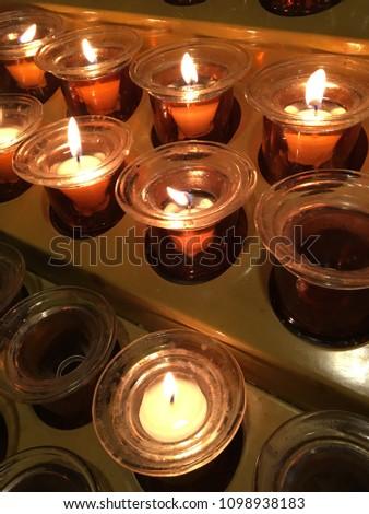 Prawy candles glow inside a church Zdjęcia stock ©