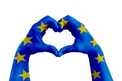 pray for europe, man hands in the form of heart with the flag of europe on the white background, concept for hope and helpful support for the european violence victims
