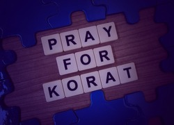 Pray for Korat, word cube with background.