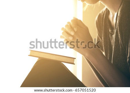 Pray in the Morning , Woman praying with hands together on white background , Woman praying while holding Bible