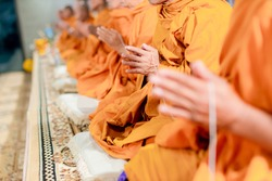 Pray of monks on ceremony of buddhist in Thailand. Many Buddha monk sit on the red carpet prepare to pray and doing buddhist ceremony.