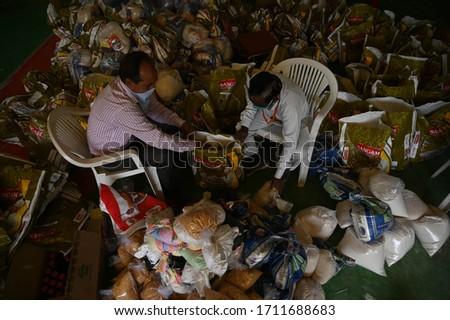 Prayagraj: Employee of PDA (Prayagraj Development Authority) pack food grains to distribute in needy people during a nationwide lockdown to prevent the spread of (COVID 19) Coronavirus in Prayagraj.