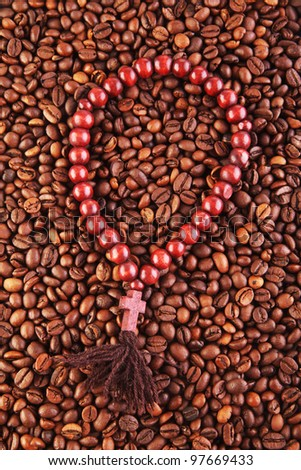 prayer beads on the roasted coffee beans