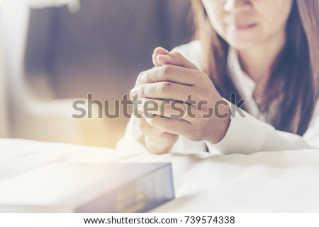 Prayer believe in god hands pray with Holy Bible by christian woman. God blessing wishing be better life. begging for forgive and believe in goodness. Christian life crisis prayer to god in church. - Shutterstock ID 739574338