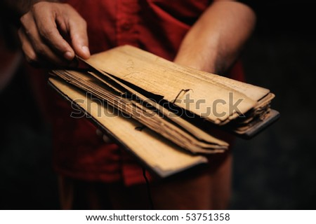 Prayer book of papyrus in the hands of monk