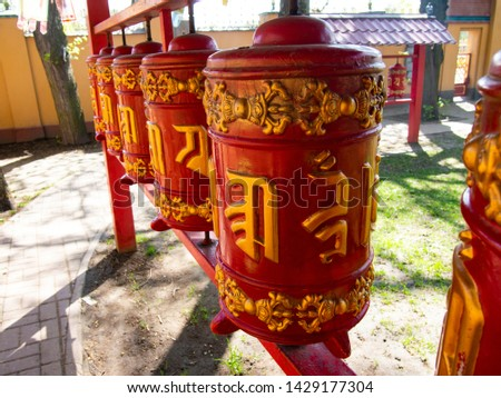 """prayer drums with mantra """"Om Mani Padme Hum"""" in Buddhist temple (Datsan)"""