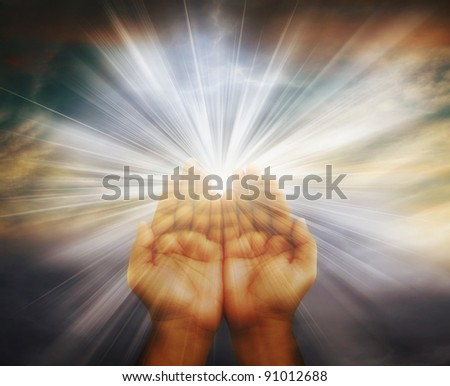 Prayer raised hands on cloudy background