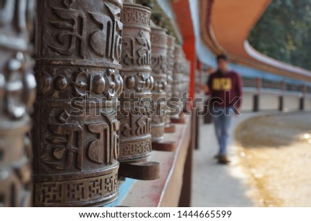 Prayer wheel at monastery in Sikkim, India. Text on the cylinder translates to Generosity, Ethics, perseverance, patience, concentration and wisdom.( om mani padme hum)