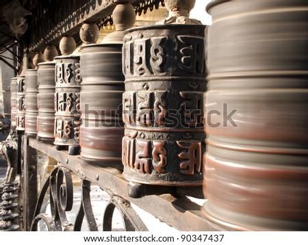 Prayer wheels at swayambhunath monkey temple in Kathmandu, Nepal