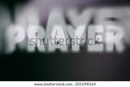 prayer word on vintage blurred...