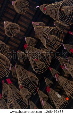 Prayers attached to conical incense coils at Thien Hau Temple, in Ho Chi Minh City, Vietnam