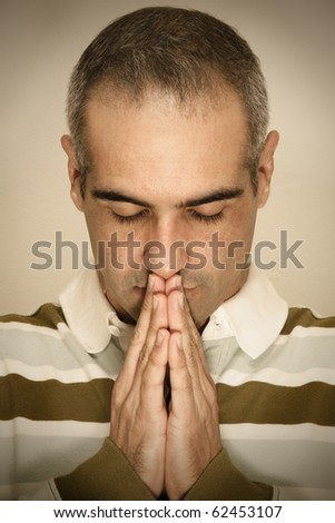 Praying and Concentrated - stock photo