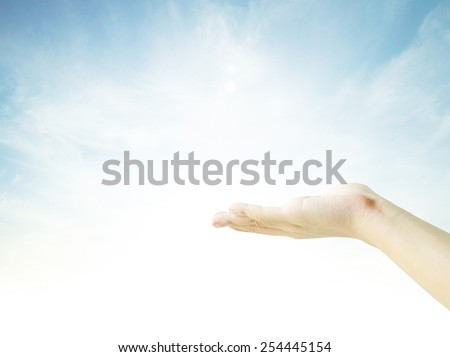 praying hands on sky background