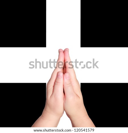 Praying hands on the white and black cross background