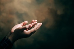 praying hands with faith in religion and belief in God on blessing background. Power of hope or love and devotion.