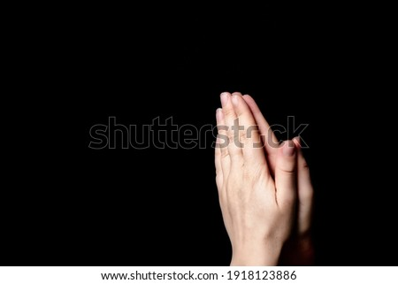 Praying hands with faith in religion and belief in God on blessing background. Power of hope or love and devotion in the dark with copy space , space for text Foto stock ©