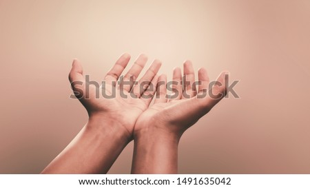 Praying hands with faith in religion and belief in God on calm background. Power of hope or love and devotion. #1491635042