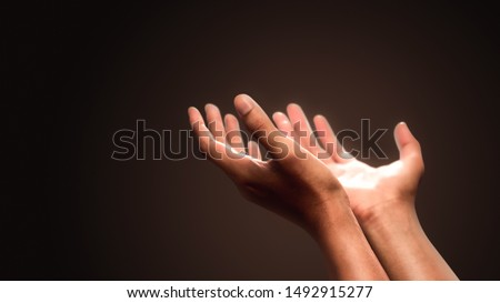 Praying hands with faith in religion and belief in God on dark background. Power of hope or love and devotion. #1492915277